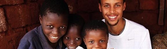 NBA star Stephen Curry with Tanzanian children