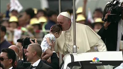 pope francis kissing child