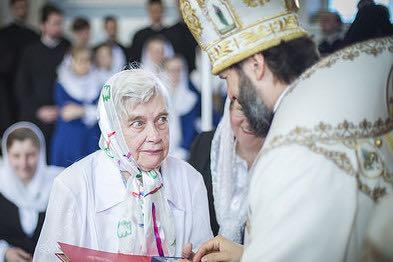 woman skeptical of priest